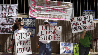 Protesters are seen in June 2011 in support of the Tucson Unified School District's Mexican-American studies program. A new state law effectively ended the program saying it was divisive. Ross D. Franklin/AP