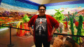 """Justin Favela, 30 year old artist from Las Vegas poses in front of his exhibit """"Fridalandia"""""""