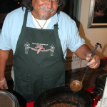 Daniel Escalente of Casa Alvraez of Taos, NM serves up some of their delicious green chile.
