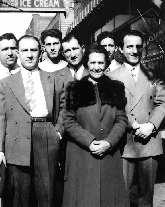Family Photo Mamie Smaldone with her six sons outside of the family bar on Tejon Street. (Courtesy of the Smaldone Family). Photo by Colorado Life Magazine