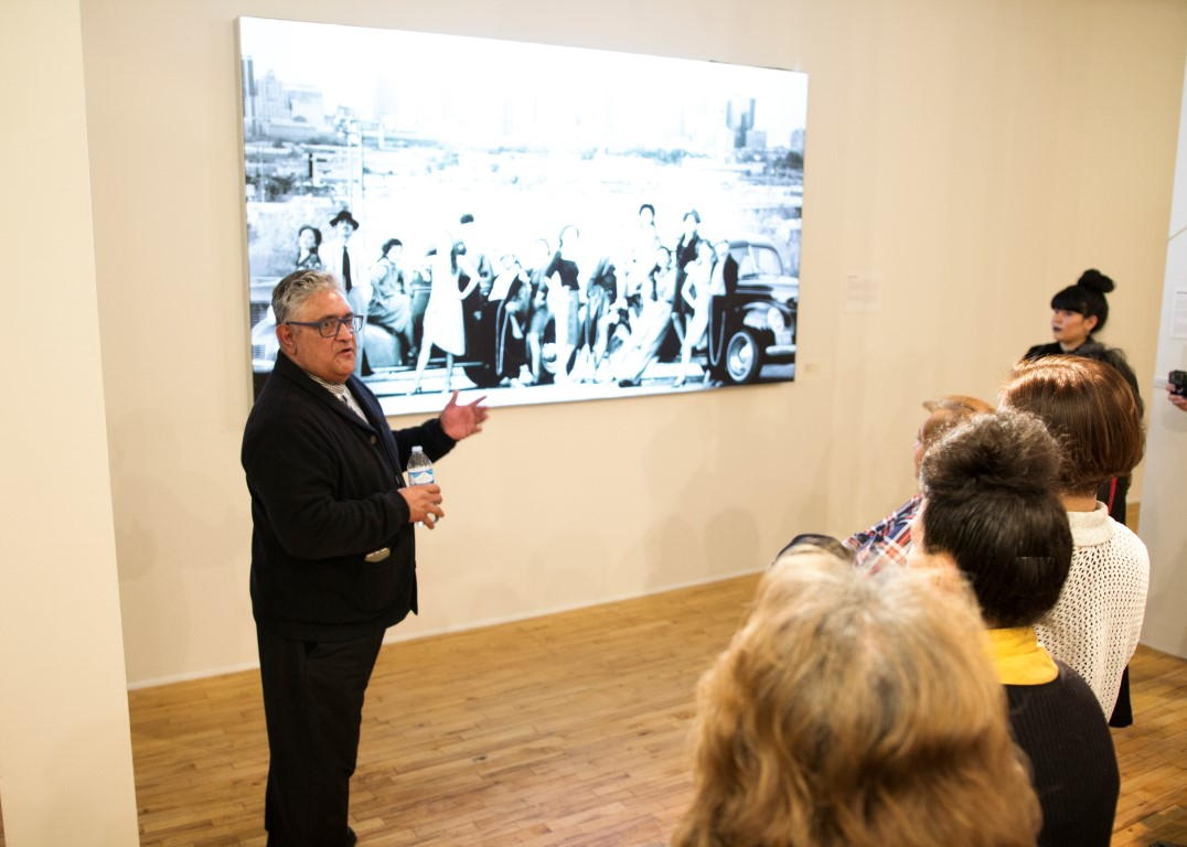 Daniel Salazar, an art veteran of Denver Colorado, talks bout the Pachuco legacy with his portraits of the National Chicano Dance Theater. Photo was taken in 1979 at Rubyu Hill Park