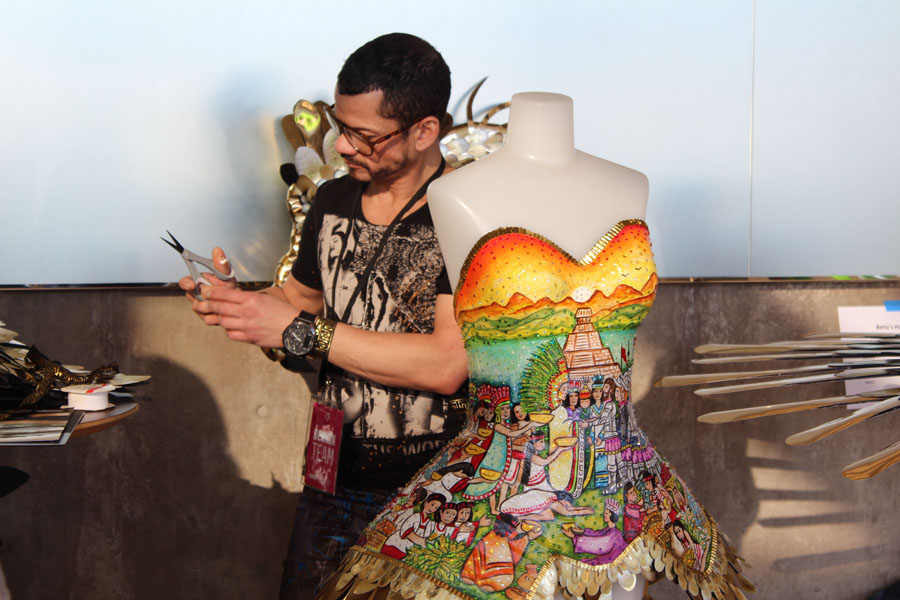 The hand painted corset tells the story that inspired the artist Norberto Mojardin, Photo by Jonathan Garcia