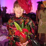 Dr. Patricia Baca, Board Trustee for the Denver Ctr. of the Performing Arts represents her table on the runway for the Macy's Parade of Hats.