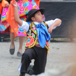A member from Qhaswa Peru USA dance group passionately performs for the crowd