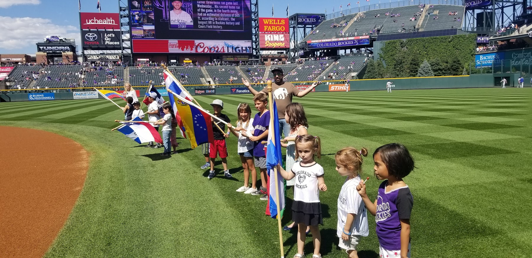 On field Latin Country Flag Presentation with students from the International School of Denver