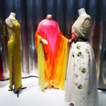 Renown Mexican film actress María Félix wore this chiffon evening dress (center) designed by Marc Bohan for Christian Dior. The Chiffon and embroidered faille  evening gown on the right was worn by Elizabeth Taylor.