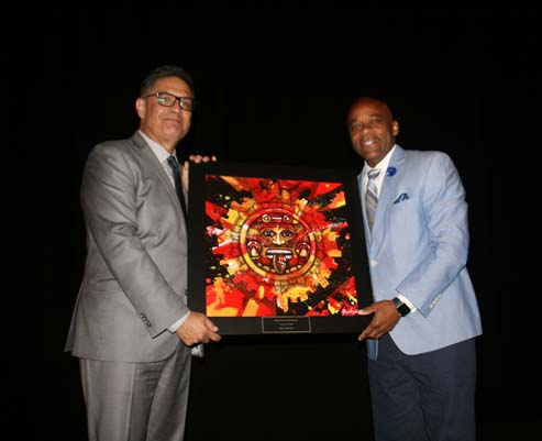 "Denver Mayor Michael Hancock receives the ""Community Builder Award"" from Rudy Gonzales"