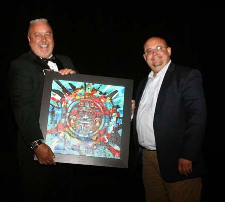 "Joseph A. Salazar is a former Democratic Charles ""Chaz"" Tedesco (left) is presented with the Civic Champion Award from Joseph A. Salazar, former Democratic member of the Colorado House of Representatives, serving from 2013 to early 2019."
