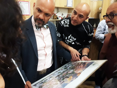Director Hugo Carbahal (left) & Writer Bobby LeFebre look over a print of Denver's Northside brought in by an audience member