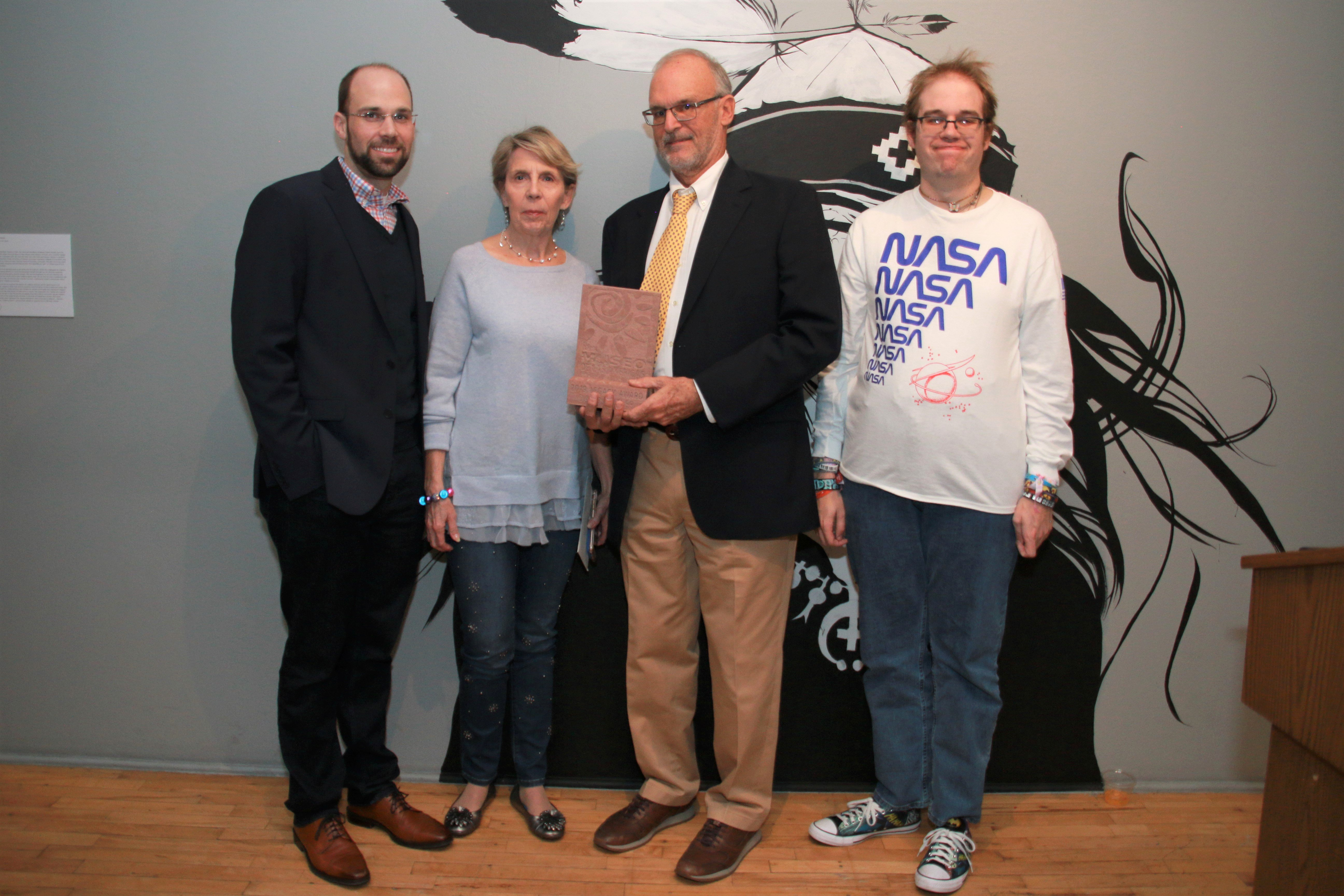 David Butler along with his wife and friends celebrate his 2019 Museo de las Americas Legacy Award. Photo by