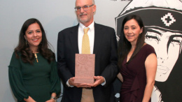 Claudia Moran, Executive Director of Museo de las Americas and Museo board bember Elizabeth Munoz present David Butler with the 2019 Legacy Award. Photo by  Vicente Campos.