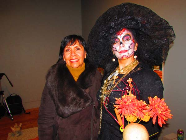 Consul General of Mexico Bernice Rendon Talavera poses with one of the many Catrinas taking part in the festivities. Photo by Latin Life Denver Media.