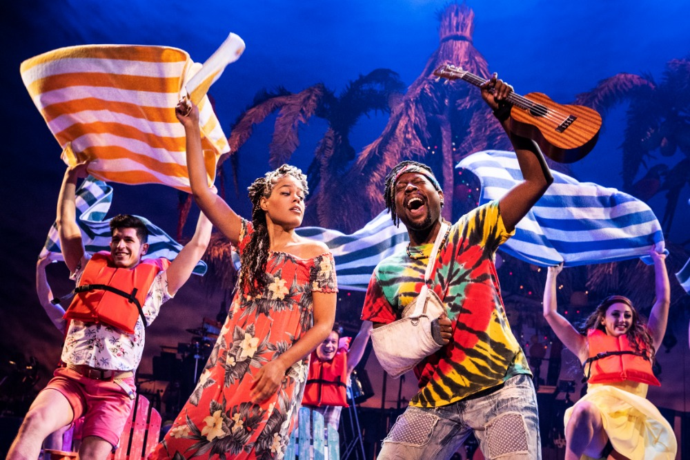 Rachel Lyn Fobbs as Marley, Matthew James Sherrod as Jamal and Company in Jimmy Buffett's ESCAPE TO MARGARITAVILLE. © Matthew Murphy