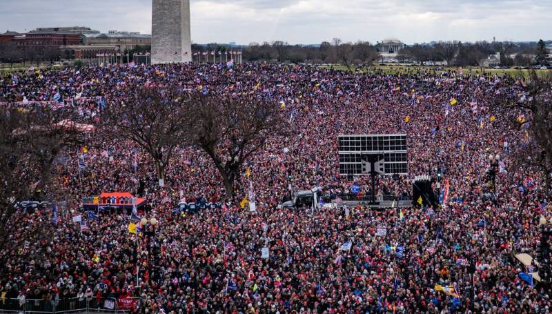 Spectators crowded the National Mall as President Trump spoke at a rally on Wednesday.Credit...Pete Marovich for The New York Times
